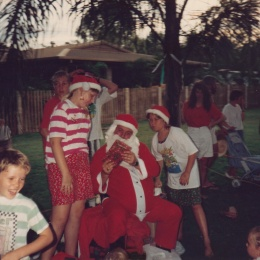 Santa distributing presents. A couple of weeks before the day parents pay a nominal amount for these.