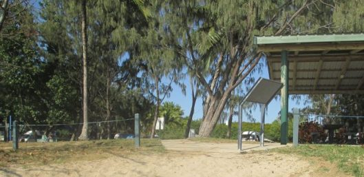 "Image 2. The interpretive sign is positioned at the entrance to the beach in Saunders Park. The <a href=""https://saundersbeachhistoryproject.com/2015/10/23/memories/"" target=""_blank"">Big Rock </a>and the mouth of <a href=""https://saundersbeachhistoryproject.com/2015/10/04/mangroves/"" target=""_blank"">Althaus Creek</a> are nearby. Image taken August 2012."