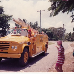 On Christmas morning Santa travels around the streets of Saunders Beach handing out drinks and lollies.